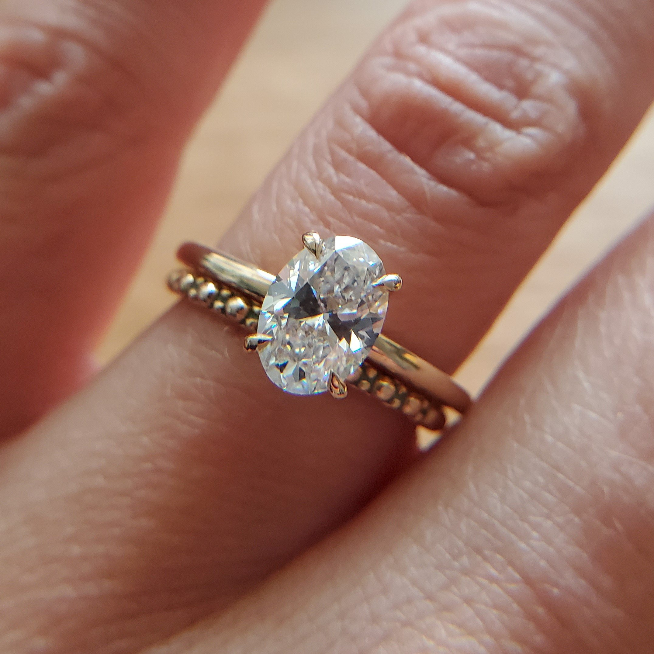 Classic oval diamond solitaire ring